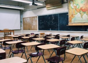 empty classroom with projector screen in front